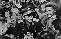 Yuri Gagarin with young Muscovites.