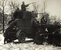 'Red Guard soldiers with a captured armoured car,