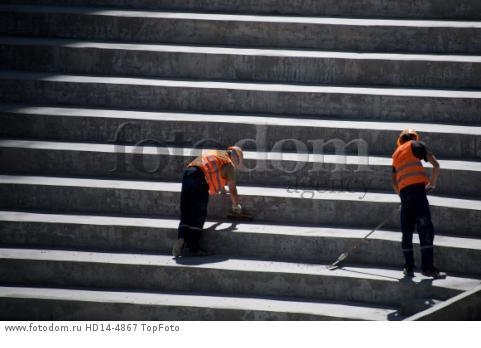 22nd August 2017, Volgograg, Russia; Construction workers sweeping the grandstands of the Volgograd Arena in Volgograd, Russia, 22 August 2017. The city is one of the locations for the Russia 2018 FIFA World Cup.