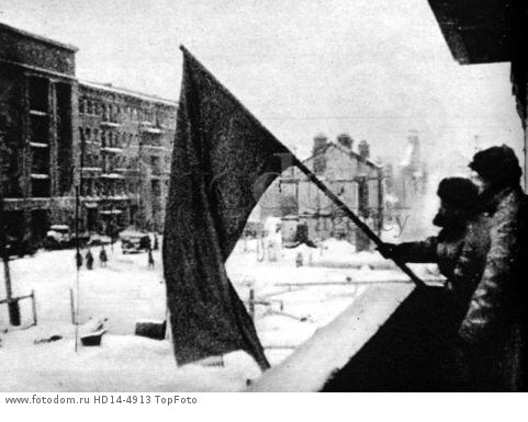 The red flag flies again from the balcony of a building in battered Stalingrad, signalling the recapture of another section of the city ©2004 Topfoto