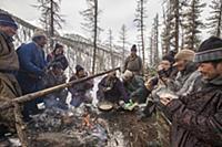 'Tsataan men drinking tea and chating in winter ca