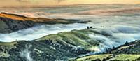Ridges engulfed by mist at sunset, Tumbledown Bay,