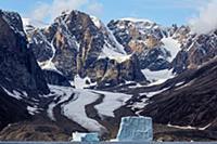Icebergs along coastal mountains and glacier, Scor