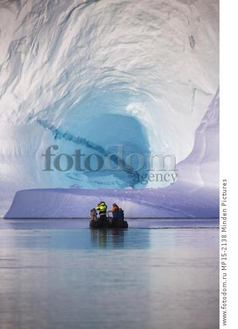 Tourists in zodiac near iceberg, Scoresby Sound, Greenland