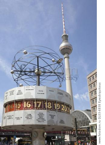 Germany, Berlin, Mitte, Alexanderplatz, the World Clock with Fernsehturm TV Tower behind.