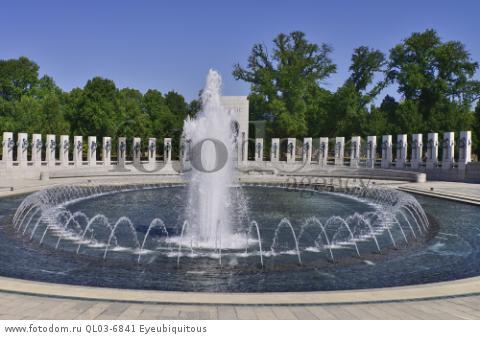 USA, Washington DC, National Mall, National World War 2 Memorial, Plaza with fountains and granite pillars.