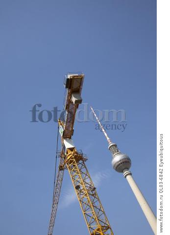 Germany, Berlin, Mitte, Fernsehturm TV Towernext to contruction crane.