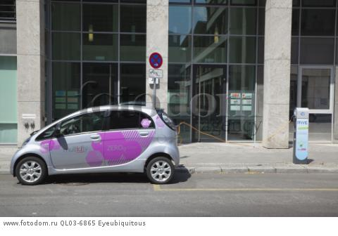 Germany, Berlin, Mitte, Citroen electric car being charged at roadside point.