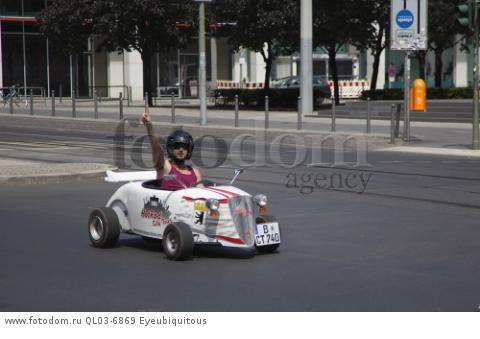 Germany, Berlin, Mitte, Tour of city in minature drag racing cars.