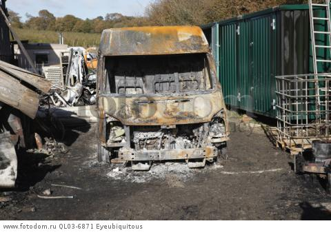 Transport, Road, Cars, Burnt out Ford Transit van in farmyard.
