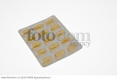 Health, Medicines, Yellow capsules in blister pack.