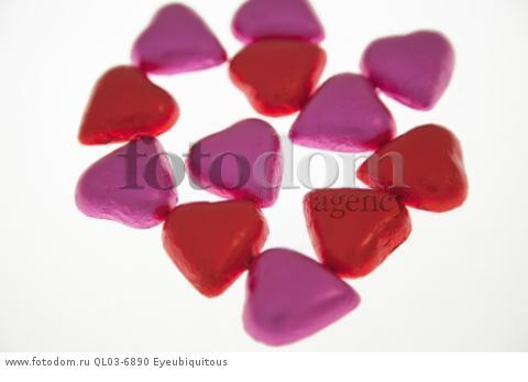 Food, Confections, Chocolate hearts covered in pick and red coloured foil.
