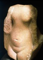 Quartzite torso of a woman in Amarna style. Countr