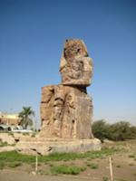 One of the colossi of Memnon. The twin statues dep