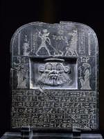 Reverse view of Horus stele, with relief mask of t