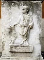 Funerary relief of a child with a goat. The inscri