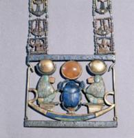 A pendant from the tomb of Tutankhamun. Two baboon
