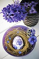 Easter egg decorated with purple napkin decoupage