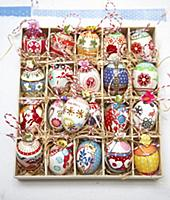 Colourfully painted Easter eggs in a seedling tray