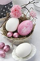 Easter arrangement with straw nest in dish, Easter