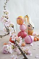 Easter arrangement of dyed eggs, chocolate rabbit