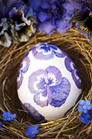 Easter egg decorated with purple, napkin decoupage