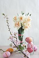 Easter arrangement of dyed eggs, narcissus & sprig