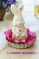 White chocolate Easter bunny on tissue paper in ta
