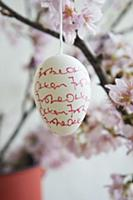 Easter egg decorated with handwriting hanging from