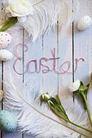 Easter arrangement of eggs, feathers, flowers & 'E