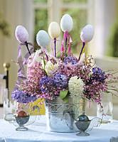 Easter arrangement of hyacinths decorated with egg
