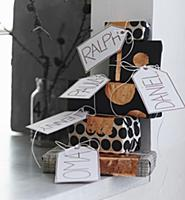 Stack of gifts wrapped in black and white paper wi