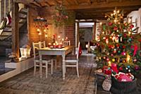 A decorated Christmas tree and a dining table in a