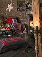A cosy corner in a fireplace room decorated for Ch