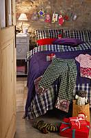 Presents on a bed in a bedroom decorated for Chris