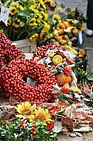 Wreath of rosehips and natural craft utensils on a