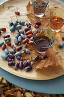 An autumnal table decoration made from painted aco