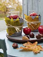 DIY lanterns with autumnal leaves, chestnuts and a