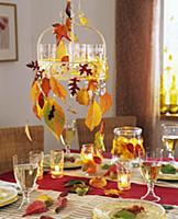 Hanging metal tray with tealights and autumn leave