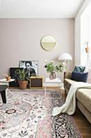 Sofa, side table, standard lamp, mirror and rug in