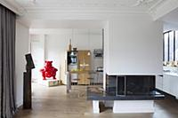 Open fireplace used as partition between living ro