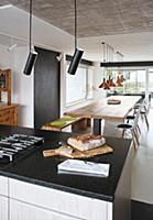 Bread on island counter and dining table with wood