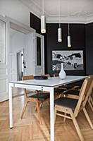 Elegant black-and-white dining room in period apar
