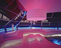 Futuristic living room illuminated in pink and blu