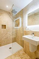Mirror with indirect lighting in bathroom in sandy