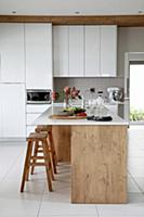 Island counter and wooden bar stools in elegant wh