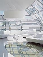 Futuristic living room with glass ceiling and glas