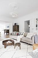 Pale sofa with scatter cushions, coffee table and