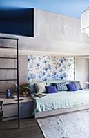 Modern, concrete bunk beds in blue and grey bedroo
