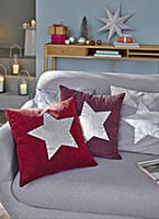 Homemade cushions with silver stars for Christmas